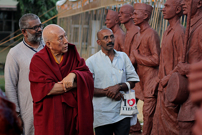 Venerable Prof Samdhong Rinpoche, Former Prime Minister of Tibetan Government in Exile examines life-size sculptures of 1930 Salt Satyagrahis made by Sculptors from India and abroad. yEeldtho Mathew, Founding Member of Friends of Tibet Foundation for the Wellbeing and Sethu Das, Coordinator, Dandi Memorial Project next to him. Prof Rinpoche observed that 'these sculptures are not mere works of art alone, they are more of an expression of gratitude to the Mahatma and the unsung heroes of Dandi Salt Satyagraha.'