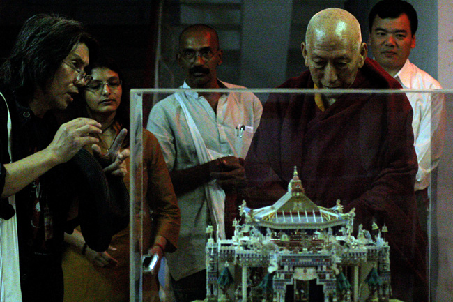 Atsuro Seto (Left), one of the Dandi Memorial Sculptors from Japan explains his 3D Mandala installation to Venerable Prof Samdhong Rinpoche, Former Prime Minister of Tibetan Government in Exile during his visit to IIT Bombay on December 22, 2013. Yeldtho Mathew and Rashmi Sidharthan of Friends of Tibet Foundation for the Wellbeing and Tenzin Dhonyoe, Personal Secretary to Prof Rinpoche next to him. Prof Samdhong Rinpoche was on a three-day visit to the campus in in connection with the Dandi Memorial Sculptures' Workshops organised by IITB.