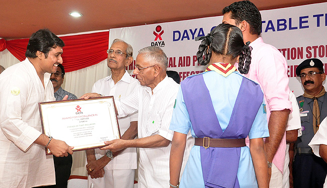 Honorable Governor of West Bengal and former National Security Advisor HE Shri MK Narayanan presents <B>'Award for Excellence in Social Service' to 'Friends of Tibet Foundation for the Wellbeing'</B> for its 'outstanding and tireless efforts in addressing and raising awareness about social issues and causes'. Shri Eswar Anandan (Left), Campaigner, Friends of Tibet  received the award on the behalf of the organisation at a function organised by Daya Charitable Trust on March 15, 2014. Justice Shri Chettur Sankaran Nair and Shri P Sanjumon, Chairman, Daya Charitable Trust (DCT) are also seen. (Photo: DCT)