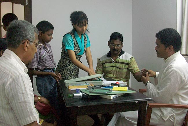 Dr Dorjee Rapten Neshar, Chief Medical Officer of Bangalore branch clinic of Men-Tsee-Khang conducting Pulse Diagnosis during the Men-Tsee-Khang medical camp at Kochi on October 13, 2010.