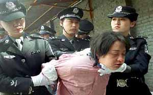 woman prisoner being taken for her execution after she was sentenced