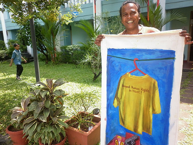 Brush Strokes For Freedom: Allennott's 'Shirt on Red Hanger' painting was made during the 2008 world-wide Olympic Protests. In recognition to the contributions of Friends of Tibet in highlighting the Tibet issue, Allennott donated two of these paintings, during his visit to the Wellbeing Camp, Kochi. (Photo: Friends of Tibet)